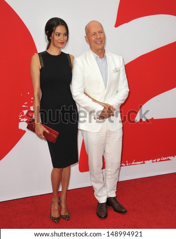 """LOS ANGELES, CA - JULY 11, 2013: Bruce Willis & wife Emma Heming at the Los Angeles premiere of his new movie """"Red 2"""" at the Westwood Village Theatre.  - stock photo"""