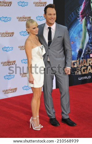 "LOS ANGELES, CA - JULY 21, 2014: Chris Pratt & wife Anna Faris at the world premiere of his movie ""Guardians of the Galaxy"" at the El Capitan Theatre, Hollywood.  - stock photo"