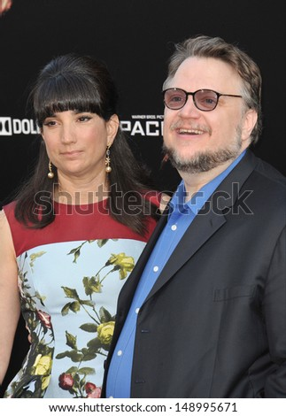 LOS ANGELES, CA - JULY 9, 2013: Director Guillermo del Toro & wife Lorenza Newton at the premiere of his new movie Pacific Rim at the Dolby Theatre, Hollywood.  - stock photo