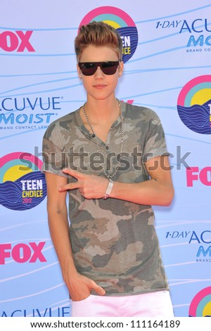 LOS ANGELES, CA - JULY 23, 2012: Justin Bieber at the 2012 Teen Choice Awards at the Gibson Amphitheatre, Universal City. - stock photo
