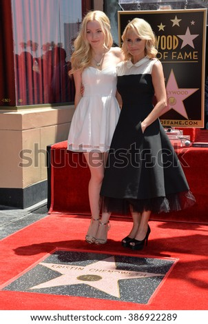 LOS ANGELES, CA - JULY 24, 2015: Kristin Chenoweth & Dove Cameron (left) on Hollywood Blvd where Chenoweth was honored with the 2,555th star on the Hollywood Walk of Fame. - stock photo