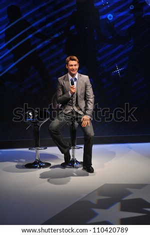 LOS ANGELES, CA - JULY 21, 2009: Ryan Seacrest waxwork figure - grand opening of Madame Tussauds Hollywood. - stock photo