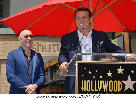 LOS ANGELES, CA. July 15, 2016: Singer Pitbull (Armando Christian Perez) with motivational speaker Tony Robbins on Hollywood Blvd where Pitbull was honored with the 2,584th star