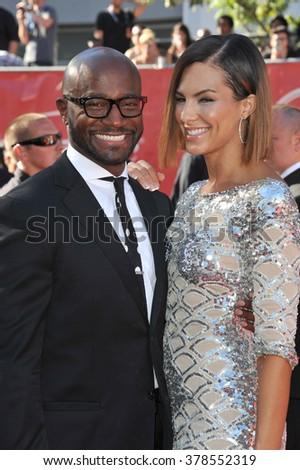 LOS ANGELES, CA - JULY 16, 2014: Taye Diggs & Amanza Smith Brown at the 2014 ESPY Awards at the Nokia Theatre LA Live.