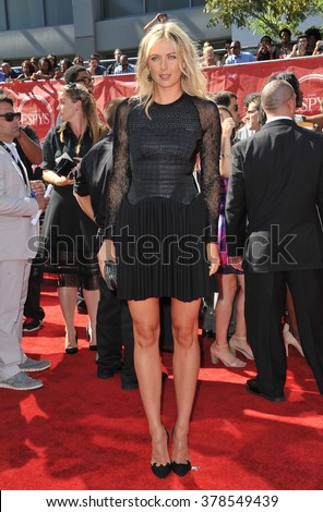 LOS ANGELES, CA - JULY 16, 2014: Tennis star Maria Sharapova at the 2014 ESPY Awards at the Nokia Theatre LA Live. - stock photo