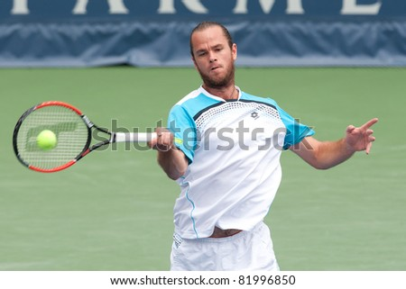 LOS ANGELES, CA. - JULY 31: Xavier Malisse (BEL) in action during the 2011 Farmers Classic doubles final on July 31 2011 in Los Angeles.