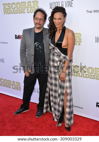 "LOS ANGELES, CA - JUNE 22, 2015: Actress Amber Dixon Brenner & husband editor David Brenner at the Los Angeles premiere of ""Escobar: Paradise Lost"" at the Arclight Theatre, Hollywood.   - stock photo"