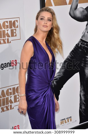 "LOS ANGELES, CA - JUNE 25, 2015: Actress Amber Heard at the world premiere of her movie ""Magic Mike XXL"" at the TCL Chinese Theatre, Hollywood.  - stock photo"