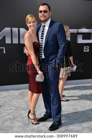 "LOS ANGELES, CA - JUNE 28, 2015: Actress Beth Behrs & boyfriend actor Michael Gladis at the Los Angeles premiere of ""Terminator Genisys"" at the Dolby Theatre, Hollywood.  - stock photo"