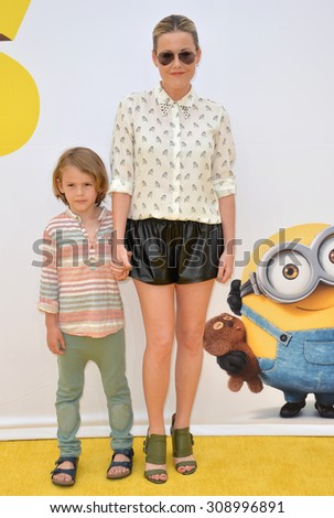"LOS ANGELES, CA - JUNE 27, 2015: Actress Kathleen Robertson & son William at the Los Angeles premiere of ""Minions"" at the Shrine Auditorium.  - stock photo"