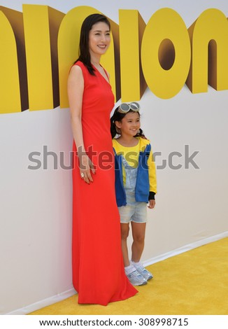 "LOS ANGELES, CA - JUNE 27, 2015: Actresses Yuki Amami & Saika Fujita at the Los Angeles premiere of ""Minions"" at the Shrine Auditorium.  - stock photo"