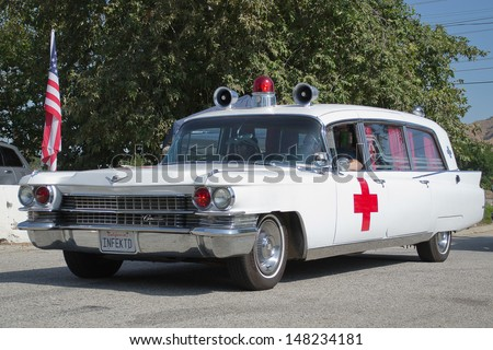 LOS ANGELES, CA. -  JUNE 29 : American Heroes Air Show -Old Ambulance  on June 29, 2013 in Los Angeles, CA. - stock photo