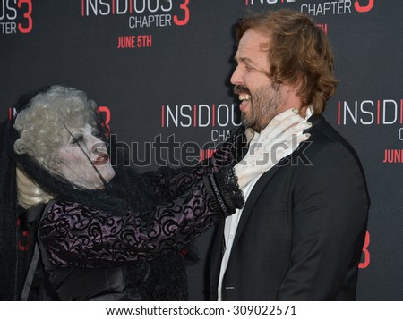 LOS ANGELES, CA - JUNE 5, 2015: Angus Sampson & The Black Bride at the world premiere of their movie Insidious Chapter 3 at the TCL Chinese Theatre, Hollywood.  - stock photo