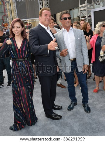 "LOS ANGELES, CA - JUNE 28, 2015: Arnold Schwarzenegger, Jane Zhang & Sylvester Stallone at the premiere of Schwarzenegger's movie ""Terminator Genisys"" at the Dolby Theatre."