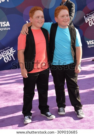 """LOS ANGELES, CA - JUNE 9, 2015: Benjamin Royer & Matthew Royer at the Los Angeles premiere of Disney-Pixar's """"Inside Out"""" at the El Capitan Theatre, Hollywood.  - stock photo"""