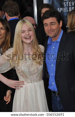 "LOS ANGELES, CA - JUNE 8, 2011: Elle Fanning & Kyle Chandler at the Los Angeles premiere of their new movie ""Super 8"" at the Regency Village Theatre, Westwood. June 8, 2011  Los Angeles, CA"