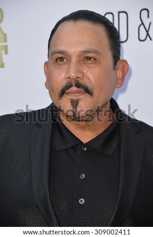 """LOS ANGELES, CA - JUNE 22, 2015: Emilio Rivera at the Los Angeles premiere of """"Escobar: Paradise Lost"""" at the Arclight Theatre, Hollywood.   - stock photo"""