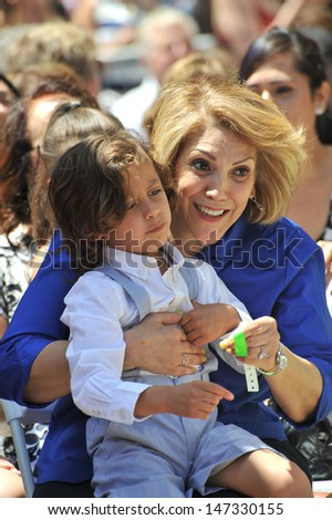 LOS ANGELES, CA - JUNE 20, 2013: Guadalupe Lopez (mother of Jennifer Lopez) & JLo's son Maximillian Davis at Jennifer Lopez Hollywood Walk of Fame ceremony.