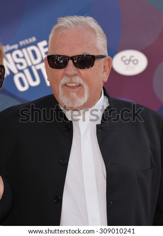 """LOS ANGELES, CA - JUNE 9, 2015: John Ratzenberger at the Los Angeles premiere of his movie Disney-Pixar's """"Inside Out"""" at the El Capitan Theatre, Hollywood.  - stock photo"""