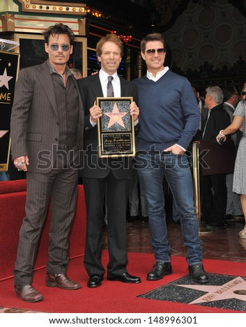 LOS ANGELES, CA - JUNE 24, 2013: Producer Jerry Bruckheimer with Johnny Depp & Tom Cruise on Hollywood Boulevard where Bruckheimer was honored with the 2,501st star on the Hollywood Walk of Fame.  - stock photo