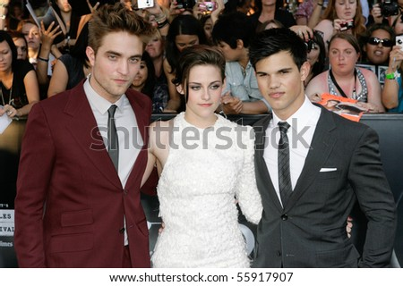 LOS ANGELES, CA. - JUNE 24: Taylor Lautner (R) Kristen Stewart (M) & Robert Pattinson (L) attend The Twilight Saga Eclipse  Los Angeles premiere on June 24th, 2010 at The Nokia Theater in Los Angeles. - stock photo