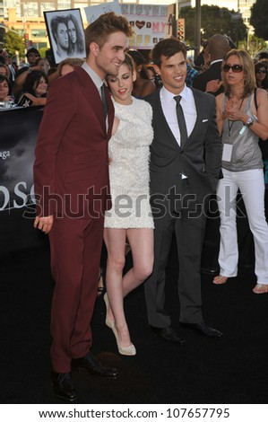 "LOS ANGELES, CA - JUNE 24, 2010: Taylor Lautner (right), Kristen Stewart & Robert Pattinson at the premiere of their new movie ""The Twilight Saga: Eclipse"" at the Nokia Theatre at L.A. Live. - stock photo"