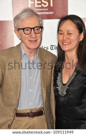 "LOS ANGELES, CA - JUNE 15, 2012: Woody Allen & Soon-Yi at the LA Film Festival premiere of his movie ""To Rome With Love"" at the Regal Cinemas LA Live. - stock photo"