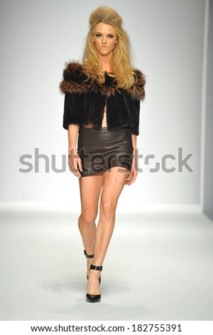 Los Angeles, CA - MARCH 13: A model walks the runway at Hallie Sara fashion show during Style Fashion Week Fall 2014 at The LA Live Event Deck on March 13, 2014 in LA.