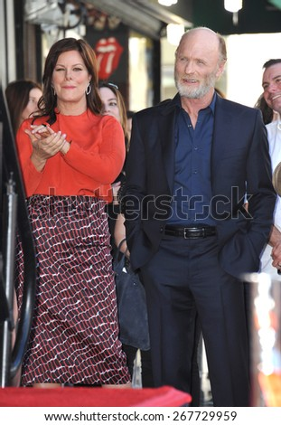 LOS ANGELES, CA - MARCH 13, 2015: Actor Ed Harris & Marcia Gay Harden on Hollywood Boulevard where he was honored with the 2,546th star on the Hollywood Walk of Fame.  - stock photo