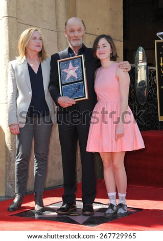 LOS ANGELES, CA - MARCH 13, 2015: Actor Ed Harris & wife Amy Madigan & daughter Lily on Hollywood Boulevard where he was honored with the 2,546th star on the Hollywood Walk of Fame.  - stock photo