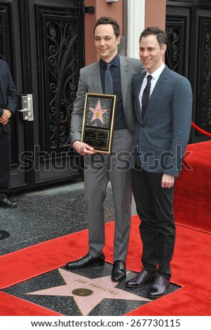 LOS ANGELES, CA - MARCH 11, 2015: Actor Jim Parsons & partner Todd Spiewak on Hollywood Blvd where Parsons is honored with the 2,545th star on the Hollywood Walk of Fame.  - stock photo