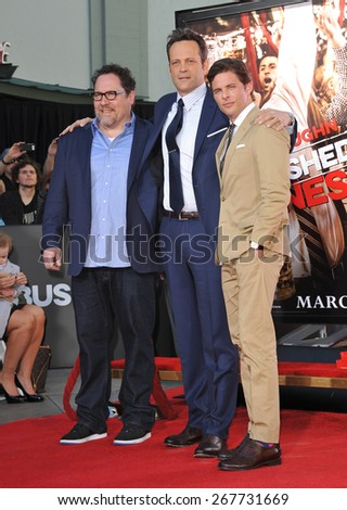 LOS ANGELES, CA - MARCH 4, 2015: Actor Vince Vaughn with Jon Favreau (left) & James Marsden at the TCL Chinese Theatre, Hollywood, where he had his hand and footprints set in cement.  - stock photo