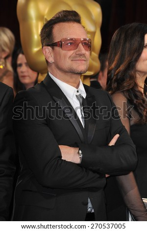 LOS ANGELES, CA - MARCH 2, 2014: Bono (of U2) at the 86th Annual Academy Awards at the Hollywood & Highland Theatre, Hollywood.  - stock photo