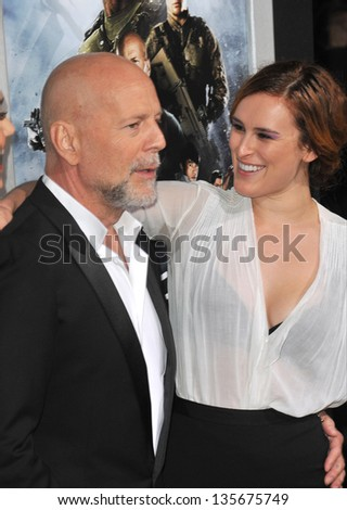 """LOS ANGELES, CA - MARCH 28, 2013: Bruce Willis & his daughter Rumer Willis at the Los Angeles premiere of his movie """"G.I. Joe: Retaliation"""" at the Chinese Theatre, Hollywood. - stock photo"""