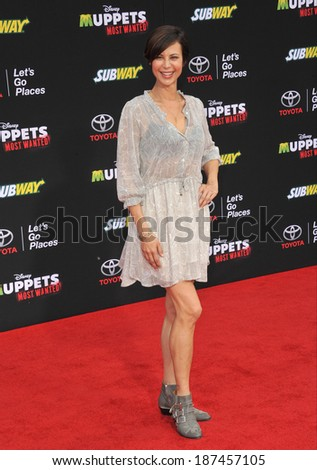 """LOS ANGELES, CA - MARCH 11, 2014: Catherine Bell at the world premiere of Disney's """"Muppets Most Wanted"""" at the El Capitan Theatre, Hollywood.  - stock photo"""