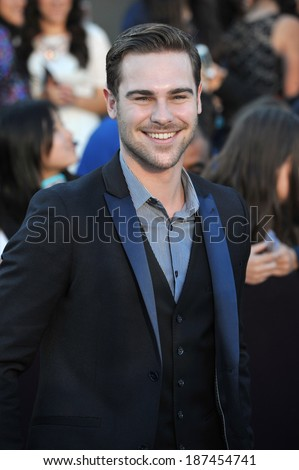 "LOS ANGELES, CA - MARCH 18, 2014: Grey Damon at the Los Angeles premiere of ""Divergent"" at the Regency Bruin Theatre, Westwood.  - stock photo"