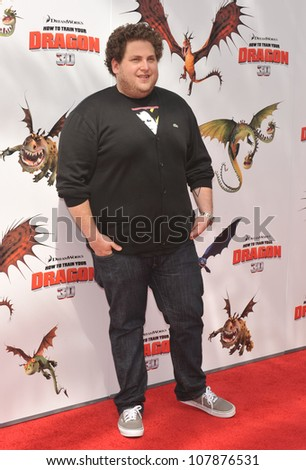 "LOS ANGELES, CA - MARCH 21, 2010: Jonah Hill at the Los Angeles premiere of Dreamworks Animation's ""How To Train Your Dragon"" at Gibson Amphitheatre, Universal Studios, Hollywood. - stock photo"