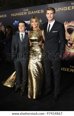 LOS ANGELES, CA - MARCH 12: Josh Hutcherson, Jennifer Lawrence, Liam Hemsworth at the premiere of Lionsgate's 'The Hunger Games' at Nokia Theater L.A. Live on March 12, 2012 in Los Angeles, California - stock photo