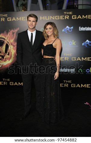 LOS ANGELES, CA - MARCH 12: Liam Hemsworth, Miley Cyrus at the premiere of Lionsgate's 'The Hunger Games' at Nokia Theater L.A. Live on March 12, 2012 in Los Angeles, California - stock photo