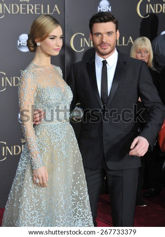 """LOS ANGELES, CA - MARCH 1, 2015: Lily James & Richard Madden at the world premiere of their movie """"Cinderella"""" at the El Capitan Theatre, Hollywood.  - stock photo"""
