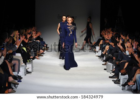 LOS ANGELES, CA - MARCH 15: Models walk the runway finale at Ozgur Masur fashion show during Concept LA Fashion Week Fall 2014 on March 15, 2014 in Los Angeles. - stock photo