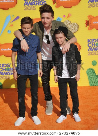LOS ANGELES, CA - MARCH 28, 2015: Romeo Beckham (left), Brooklyn Beckham & Cruz Beckham at the 2015 Kids Choice Awards at The Forum, Los Angeles.  - stock photo