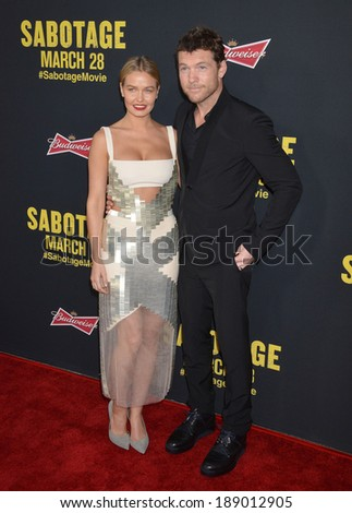 "LOS ANGELES, CA - MARCH 19, 2014: Sam Worthington & girlfriend Lara Bingle at the premiere of his movie ""Sabotage"" at Regal Cinemas L.A. Live.  - stock photo"