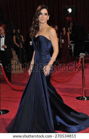 LOS ANGELES, CA - MARCH 2, 2014: Sandra Bullock?Jim Carrey at the 86th Annual Academy Awards at the Hollywood & Highland Theatre, Hollywood.  - stock photo