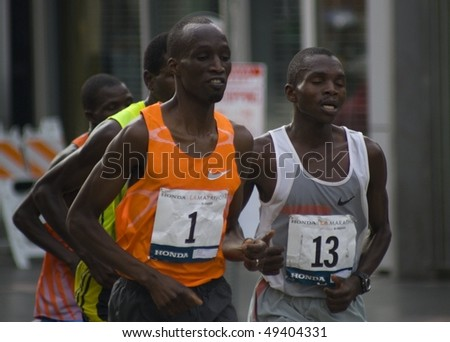 LOS ANGELES, CA - MARCH 22: Wesley Korir, rank #1, Sammy Kibet, rank#13, at 2010 LA marathon on March 22, 2010 in Los Angeles, California. - stock photo