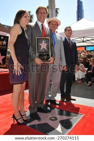 LOS ANGELES, CA - MARCH 24, 2015: Will Ferrell with Molly Shannon. John C. Reilly & L.A. Mayor Eric Garcetti on Hollywood Boulevard where he was honored with a star on the Hollywood Walk of Fame.  - stock photo