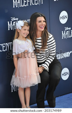"LOS ANGELES, CA - MAY 29, 2014: Ali Landry & daughter at the world premiere of ""Maleficent"" at the El Capitan Theatre, Hollywood.  - stock photo"