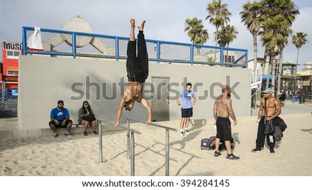 LOS ANGELES, CA - MAY 30: An unidentified male gymnast works out at Muscle Beach gym on Venice Beach, CA on May 20, 2015. Muscle Beach is a landmark outdoor gym dating back to the 1930's. - stock photo
