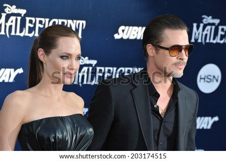 "LOS ANGELES, CA - MAY 29, 2014: Angelina Jolie & Brad Pitt at the world premiere of her movie ""Maleficent"" at the El Capitan Theatre, Hollywood.  - stock photo"