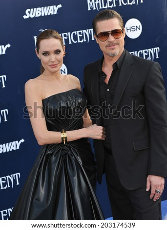 """LOS ANGELES, CA - MAY 29, 2014: Angelina Jolie & Brad Pitt at the world premiere of her movie """"Maleficent"""" at the El Capitan Theatre, Hollywood.  - stock photo"""